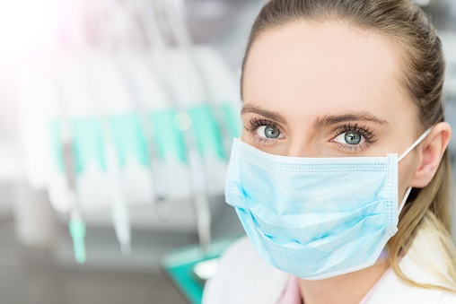 Palo Alto dental assistant wearing PPE face mask